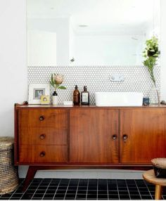 Yes to the bathroom on so many levels!! Repurposed teak sideboard, vessel sink, wall mounted plumbing fixtures, penny round wall tile. Love