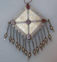 Turkmen | A Yomud pendant | Silver with gold wash