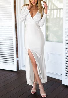 Attain that effortless style in this white lace surplice neck long dress. It comes with a lace bodice with long sleeves and a low surplice neckline with a back zipper. | Lookbook Store Dress