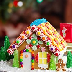 A pre-baked gingerbread house eliminates cutting and baking. Add Starbursts as roof tiles, rock candy trees and Sixlets or mini gumballs for Christmas lights. Makes the season bright! Cool Gingerbread Houses, Gingerbread House Designs, Gingerbread House Parties, Christmas Gingerbread House, Gingerbread House Decorating Ideas, Gingerbread Cookies, Christmas Treats To Make, Christmas Baking, Christmas Cookies