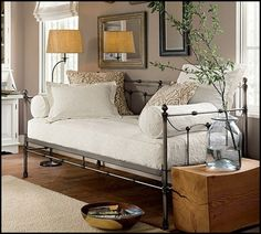 Cute iron daybed, two rolled pillows on either end