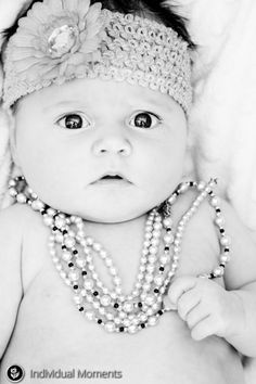 Charlotte in her Nana's pearls.... #baby #babyphotography #newborn