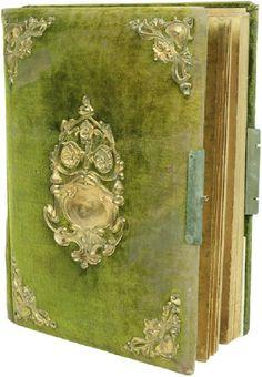 an antique velvet photo album                              …