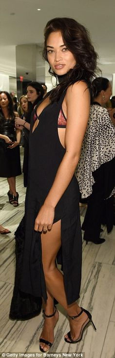 Peek-a-boo:The Australian beauty stole the show in a simple but sexy black dress whichsimultaneously showed off the model's long legs thanks to a high split and her cleavage as it had a plunging V-neckline