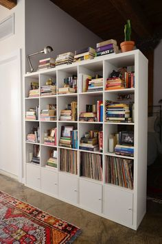 Video House Tour: A Lofty Studio Apartment in Brooklyn | Apartment Therapy. This bookcase separates an open bedroom space from the hallway yet still lets in alot of natural light.
