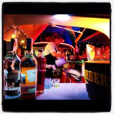VW camper van bar serving cocktails by night.