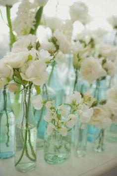 lavender-colored glasses...white flowers in aqua glass <3