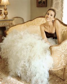 Sarah Jessica Parker- so cute- leaning on a sofa with dress all spread out