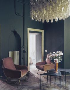 dark walls and pink chairs for Dimore Studio, image by Andrea Ferrari
