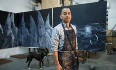 Vincent Valdez works on an eight panel painting of modern day klansmen in his studio in San Antonio.