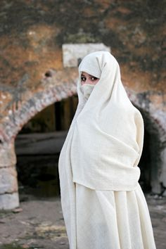 Girl in niqab.