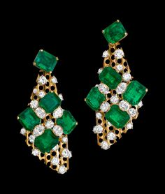 "Alexandre Reza ""La Danse"" Earrings featuring 10 Colombian emeralds weighing 36.11cts, 8 oval-shaped diamonds weighing 3.70cts surrounding brillant-cut diamonds weighing 7.13cts."