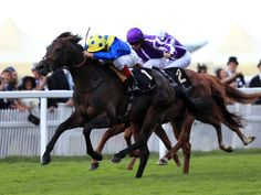 Across The Stars, ridden by Frankie Dettori, on the way to winning the King Edward VII Stakes