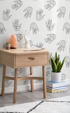 Inspired by the practice of palm reading, this pattern is a mix of modern and ancient design. The wallpaper is filled with symbols of lunar phases, eyes, arrows, snakes, suns, half-moons and more. A great decoration idea for a spiritual meditation corner or daybed space (and don't forget the incense & salt lamps). Witchy Wallpaper, Forest Wallpaper, Flower Wallpaper, Wallpaper Ideas, Pattern Wallpaper, Spiritual Decor, Spiritual Meditation, Daybed In Living Room, Childrens Shop