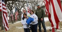 The Blass family woke up Friday mooring to hundreds of American flags in their yard as well as lining the streets of Estherville.