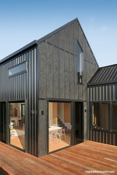 The exterior is a beauty, stained in strong Resene Pitch Black. Project by Barry Connor Design. Photo by Dennis Radermacher. House Cladding, Black House Exterior, Black Barn, Up House, Modern Barn, Exterior Design, Exterior Colors, Building A House, Beach House