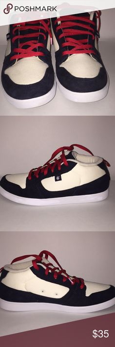 New Mens DC brand Sneakers New DC Sneakers. The navy blue part of the shoe is suede and the white part is a canvas material. The model name of the shoe is Landau Mid Unrestricted DC Shoes Sneakers