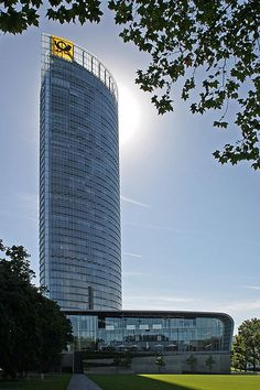 """Post Tower, Bonn. Helmut Jahn (architect) was educated in the pure Miesian style and he typifies the high-tech architect. He collaborates with structural engineers from the beginning of the design process in a relationship known as """"Archi-neering""""."""