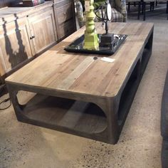 The James Coffee Table offers a natural finish top with dust gray stained base. $895.00 Cornerstone Home Interiors