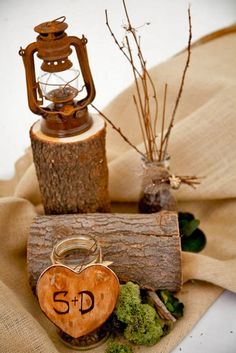 rustic tree stump wedding monogram centerpiece / http://www.deerpearlflowers.com/country-rustic-fall-wedding-theme-ideas/