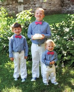 These handsome ring bearers sported Mini Boden gingham shirts, custom bow ties from Tie Crafters, and old-school Chuck Taylors