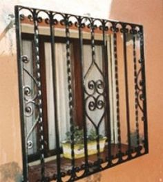 Fire Safety and the Spanish Window Security Grill - a safety feature or a death Window Security Bars, Window Grill Design Modern, Iron Window Grill, Window Protection, Burglar Bars, Iron Gate Design, Window Bars, Iron Windows, Wrought Iron Decor