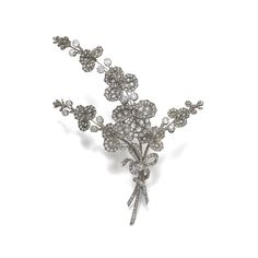 Diamond brooch, Oscar Massin, second half of the 19th century. Of foliate design, set with cushion-shaped, circular-, single-cut and rose diamonds.