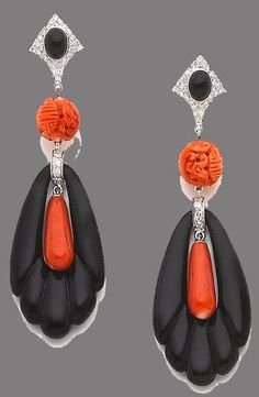 A pair of coral, onyx and diamond earrings Each brilliant-cut diamond and cabochon onyx surmount suspending a carved coral bead, terminating in a carved onyx, similarly-cut diamond and coral drop pendant, length 7.0cm