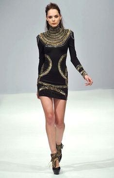 Egyptian inspired fashion. With Possiam and gold work as decor.