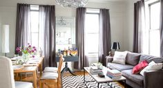 Apartment Therapy: Two-In-One Spaces | Wayfair Dark couch with matching ddrapes