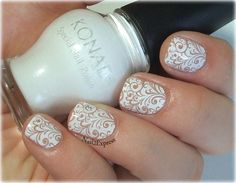White stamping nails with Konad m89