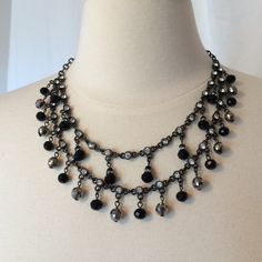 WHBM black jet and crystal dangle necklace Really pretty necklace looks great with WHBM styles. Black jet stones with clear crystals done in gun metal. Adjustable in back for length. I don't think I ever wore this, just tried on. White House Black Market Jewelry Necklaces