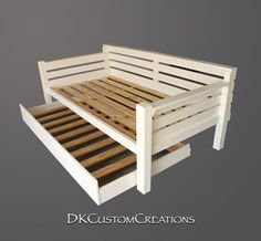 Custom made daybed and trundle. The trundle rolls out nicely. Handmade of pine wood and built to last, by DKCustomCreations.