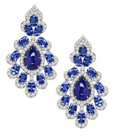Cellini Jewelers Sutra Jewels Cabochon Tanzanite Drops This stunning pair features 12.24 carats of Tanzanites, surrounded by 14.12 carats of oval cut sapphires, accented with 3.55 carats of round brilliants.