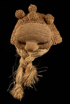 """Mask """"idangani"""" D. R. Congo, Salampasu  raffia, plant fibre, a facial plane of plaited dark brown plant fibre, the protruding forehead and the fleshy nose upholstered with wooden chips, the beard made of lose suspending fibres  H: 21 cm (without beard) Literature Grootaers, J.-L., Eisenburger, I. (ed.), Forms of Wonderment, The History and Collections of the Afrika Museum Berg en Dal, Vol. II, 2002, p. 547, ill. 651"""