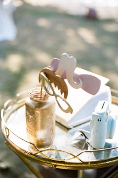 Let's face it, any wedding with Ruth Eileen behind the lens is destined for perfection. Beginning with the Bride's dove grey gown, to the astilbeaccented Beach Plum Floralbouquets, to the paper cranes, and antique finds, it's all of theseperfectly styled