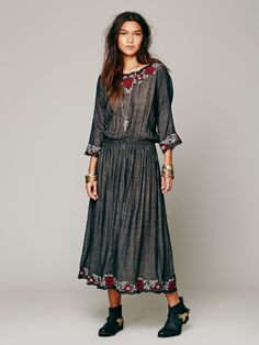 """Run Of Roses Dress in Black: maxi with embroidery and mini scalloping on the neckline, sleeves, and hemline; subtle pleating; cinched waist; semi-sheer; bust 42"""", length 54""""; sleeve 12 1/2"""".  CAD $380.29"""
