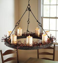 Metal chandelier dressed in berry vine garland...no electricity needed!