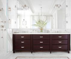 dark stained vanity + marble countertop and flooring