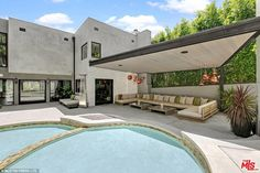 Where to lounge: Nestled by the swimming pools is a covered patio