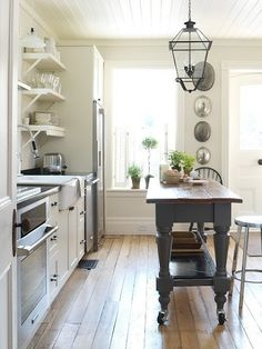 Cottage kitchen.  White + gray island + open shelving