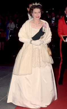 1960 from Queen Elizabeth II's Royal Style Through the Years  The Queen wore another Norman Hartnell—this time a beaded white confection—to a film premiere.