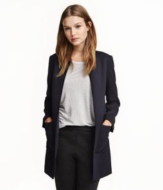 Dark blue. Short, straight-cut jacket in textured-weave fabric with front pockets and no buttons. Lined.