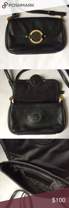 ✨NEW Listing✨Tory Burch Amanda Crossbody Tory Burch Amanda black crossbody bag is a great option to carry your essentials for running errands or an evening out. ***Graphic inlaid logo emblem lost a piece, so I removed the other to balance the look. Will include removed piece when shipping, in case, you have a way to replace missing piece.*** Removable straps give the option to carry as a clutch. Not interested in trades. 🔹Leather 🔹Gold hardware 🔹Magnetic snap closure 🔹Removable cross…