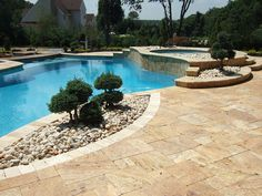 Luxury custom swimming pool design with stone paver spa, brick pavers edging, natural hardscaping and landscaping designs. Deal NJ pool designs and custom backyard landscape ideas.     Over 7,000 landscape ideas and detailed designs for patios, front yards, gardens and back yards.