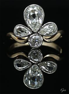 Belle Epoque Diamond ring, United Kingdom, around 1890, pear shape old European cut diamonds, old european cut diamond, 18k gold, silver, center stone: over 1 carats, weight 2.2g