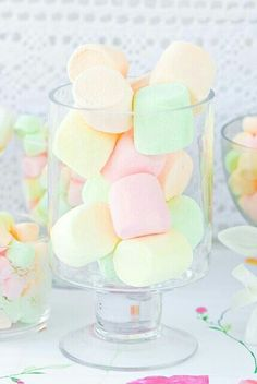 A random glass filled with pastel marshmallows.
