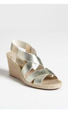 Dalmira' Wedge Metallic straps wrap a breezy sandal set on a beachy, jute wedge. Approx. heel ...