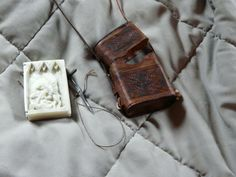 hand made wax tablet with hand stitched leather case.  http://www.brianbrownarmoury.com/