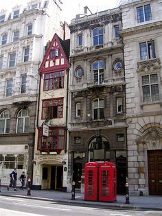 Ye Olde Cock Tavern on Fleet Street, London, originally opened its doors on the north side of the street in 1547. It has resided in this agonizingly adorable building since 1887, and was the preferred watering hole of such famous citizens as Samuel Pepys, Charles Dickens, and Dr. Johnson. (marginscribbler flickr)